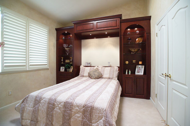Stained Wood Wall Bed & Side Cabinets bedroom