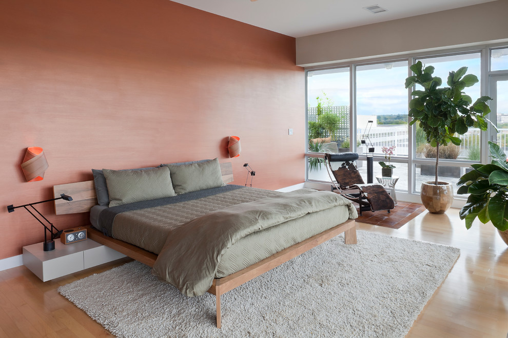 Inspiration for a large contemporary master light wood floor bedroom remodel in New York with pink walls and no fireplace