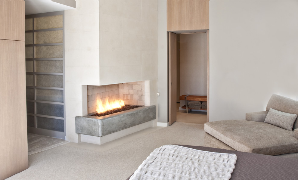 Example of a trendy bedroom design in Dallas with a concrete fireplace and a corner fireplace