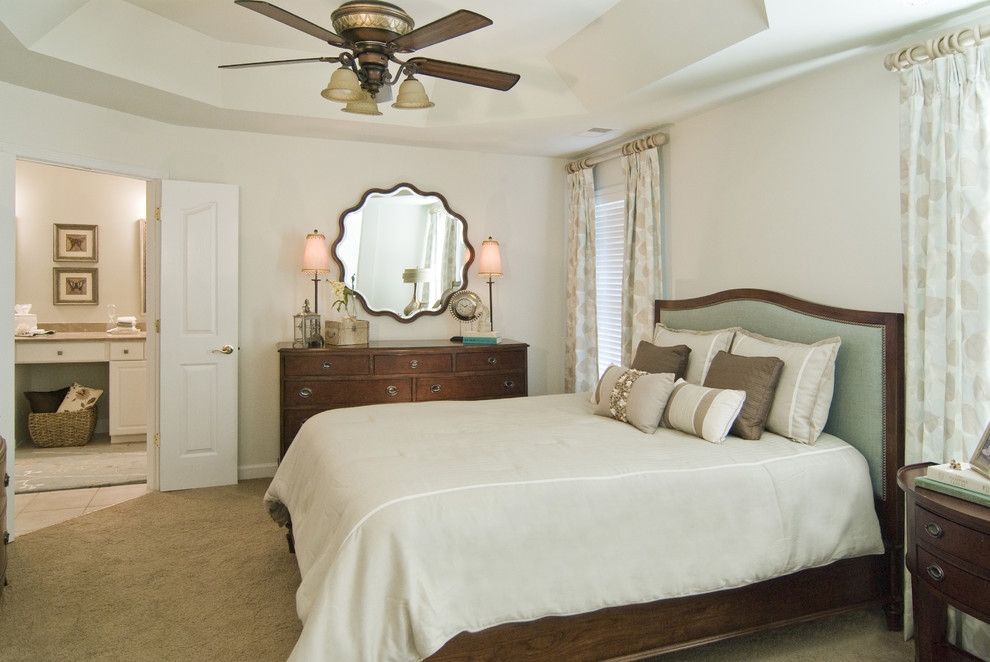 Example of a mid-sized classic master carpeted bedroom design in Charlotte with beige walls