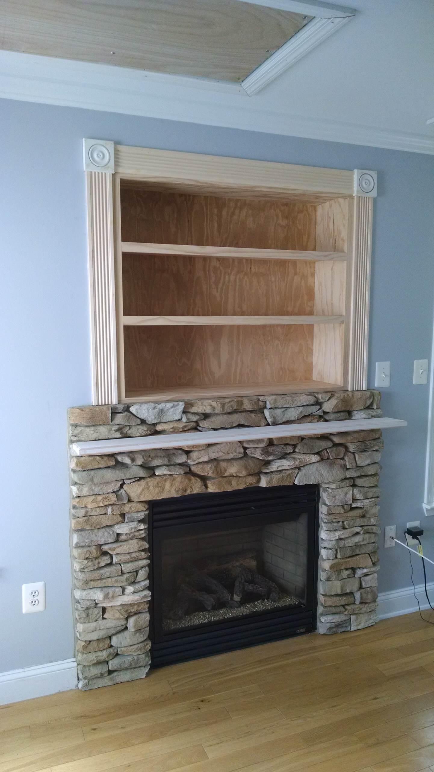 Stone fireplace with bookshelf