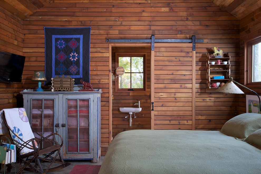 Inspiration for a rustic guest bedroom remodel in Chicago with brown walls