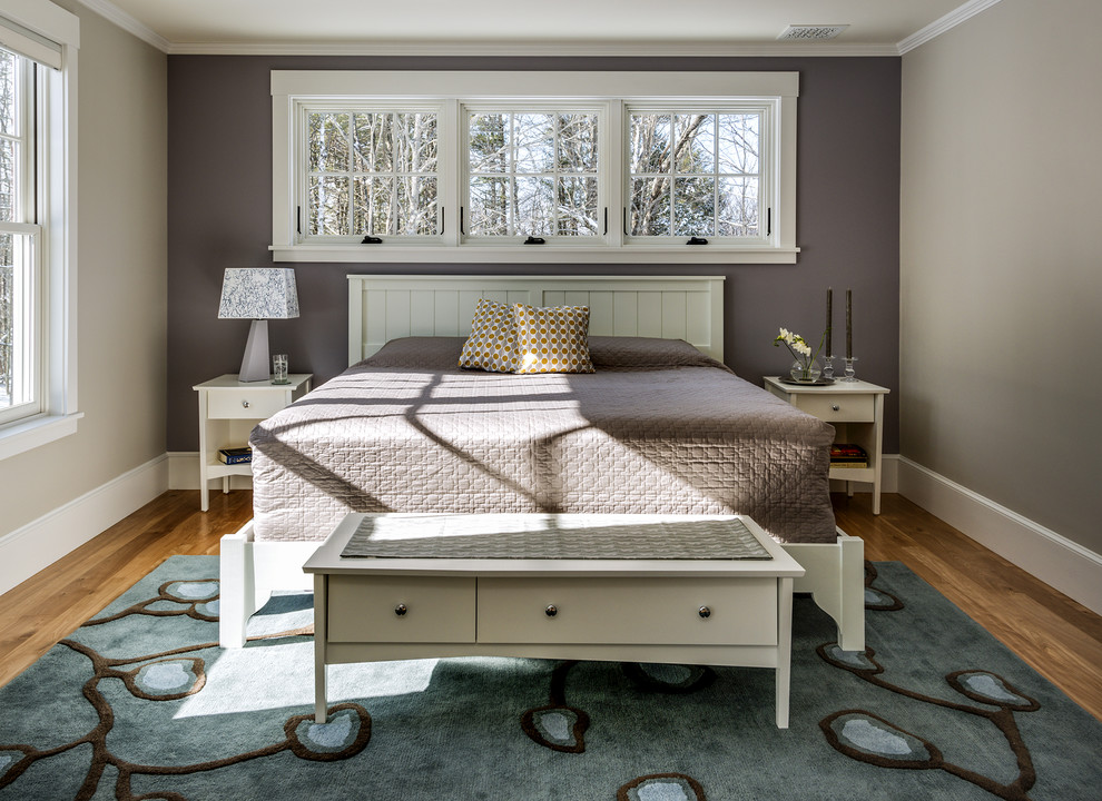 Inspiration for a large timeless master medium tone wood floor bedroom remodel in Portland Maine with purple walls