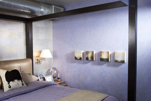 Inspiration for a small industrial loft-style bedroom remodel in Phoenix with purple walls