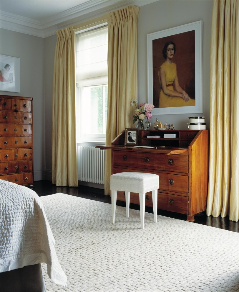 Inspiration for a medium sized contemporary bedroom in London with beige walls.