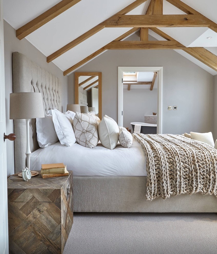 Example of a country carpeted bedroom design in San Francisco with gray walls