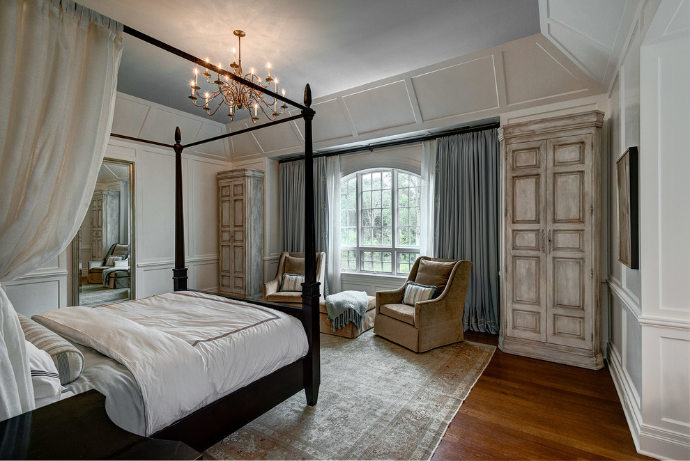 Large transitional master medium tone wood floor bedroom photo in Chicago with white walls and no fireplace