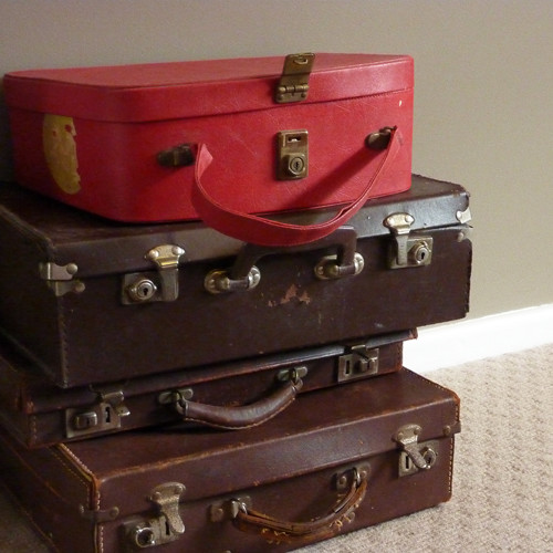 Suitcases as storage eclectic bedroom