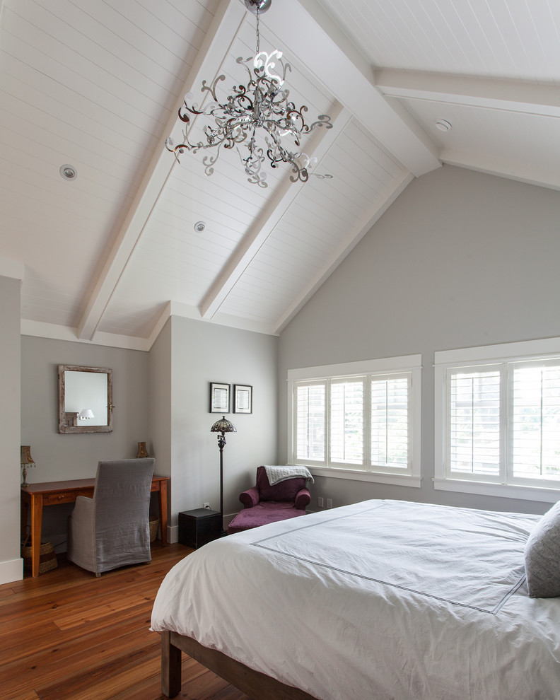 Example of a mid-sized classic master medium tone wood floor and brown floor bedroom design in Vancouver with gray walls