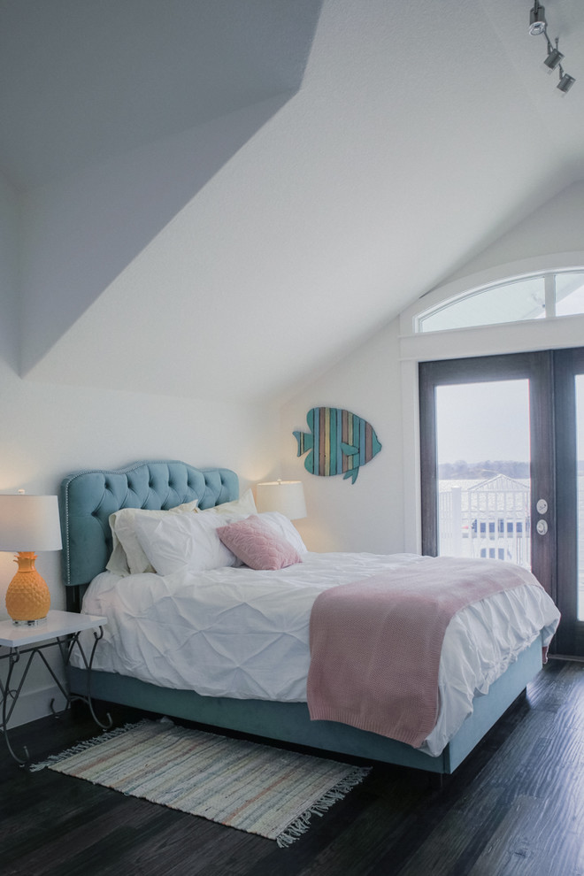 Large beach style guest dark wood floor and brown floor bedroom photo in Dallas with white walls and no fireplace