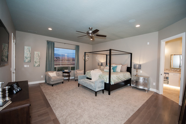 Large transitional master dark wood floor and brown floor bedroom photo in Salt Lake City with gray walls