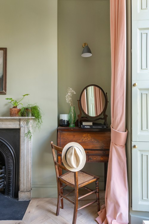 Glamorous, small space vanity idea: use a vintage desk with storage as a vanity