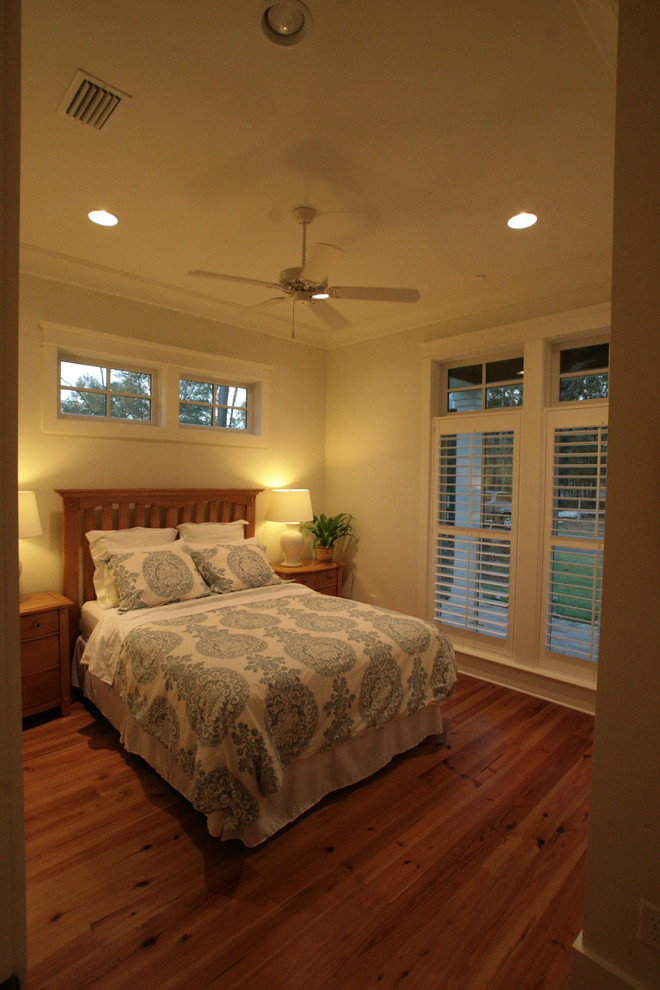 Mid-sized elegant guest medium tone wood floor bedroom photo in Other with gray walls and no fireplace