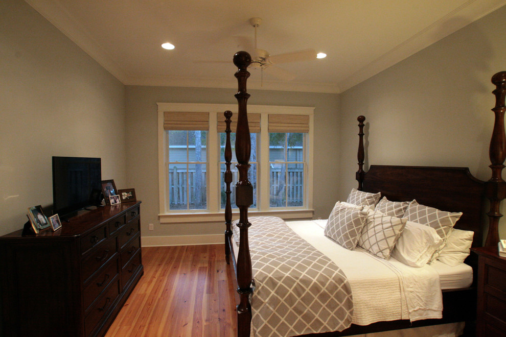 Inspiration for a mid-sized craftsman master medium tone wood floor bedroom remodel in Other with gray walls and no fireplace