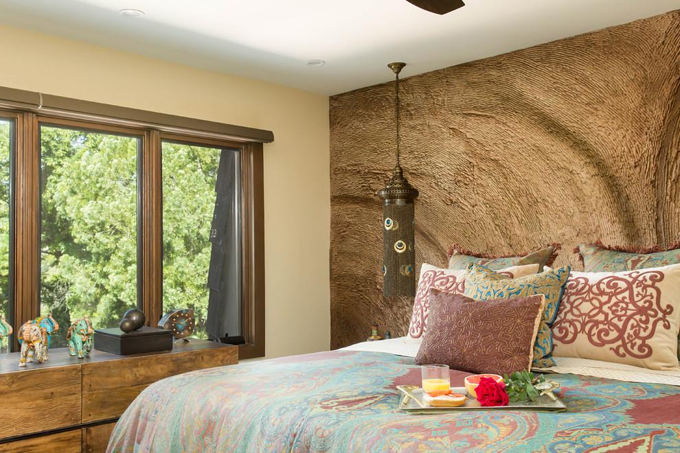 Bedroom - mid-sized mediterranean master light wood floor and beige floor bedroom idea in Los Angeles with beige walls