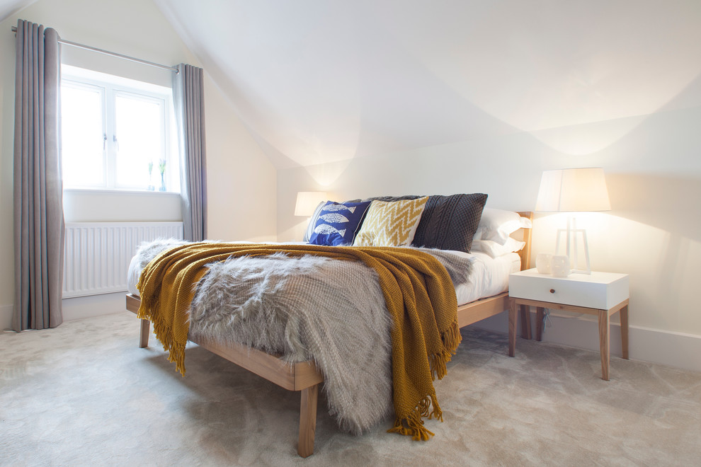 Danish carpeted bedroom photo in Dorset with white walls