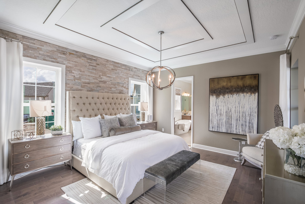 Inspiration for a transitional master medium tone wood floor and brown floor bedroom remodel in Orlando with brown walls