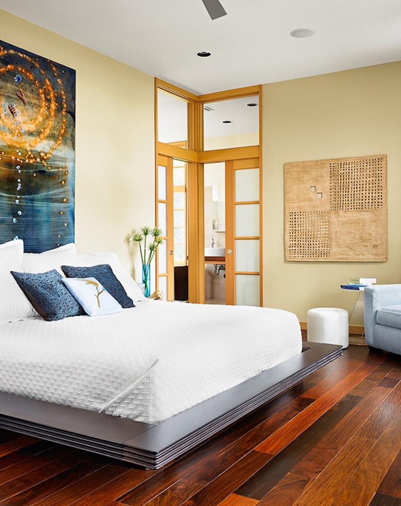 Example of a mid-sized asian master dark wood floor and brown floor bedroom design in Austin with beige walls