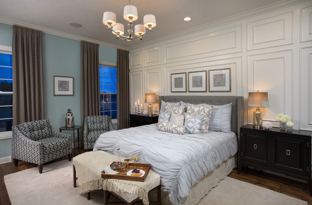 Example of a transitional guest dark wood floor bedroom design in Columbus  with blue walls