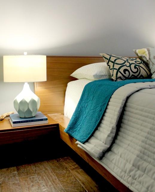 Teal And Aqua Bedding On Wooden Platform Bed