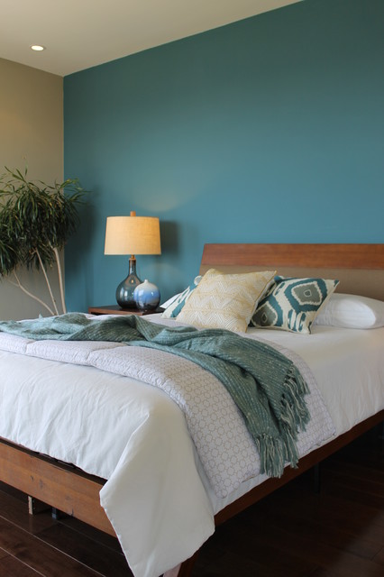 Beautiful Teal Blue Wall, Ikat Pillows, Seeded Glass Lamps Modern Bedroom