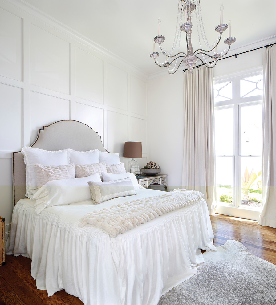 Inspiration for a transitional medium tone wood floor bedroom remodel in Nashville with white walls
