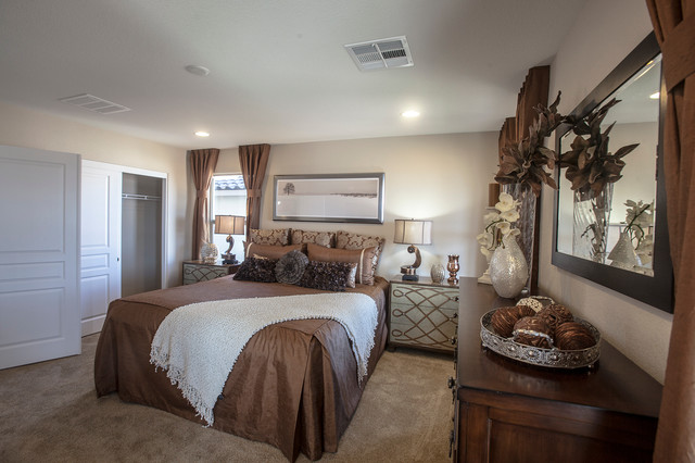 Example of a mid-sized classic guest carpeted bedroom design in Las Vegas with beige walls