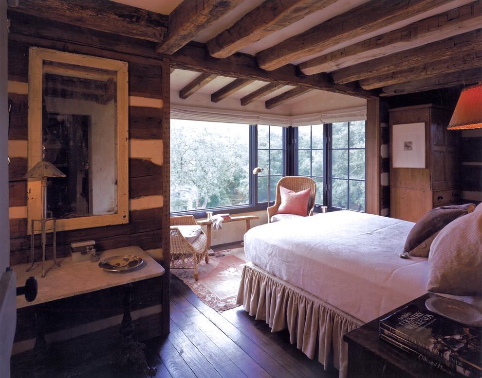 Bedroom - rustic dark wood floor bedroom idea in Austin