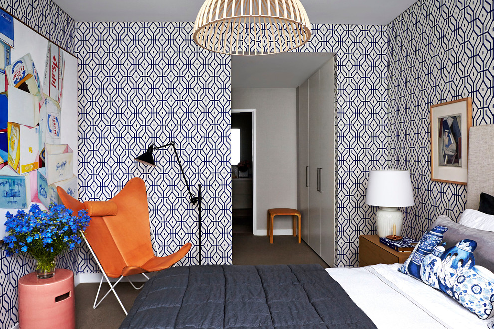 Example of a mid-sized trendy master carpeted bedroom design in Sydney with multicolored walls and no fireplace