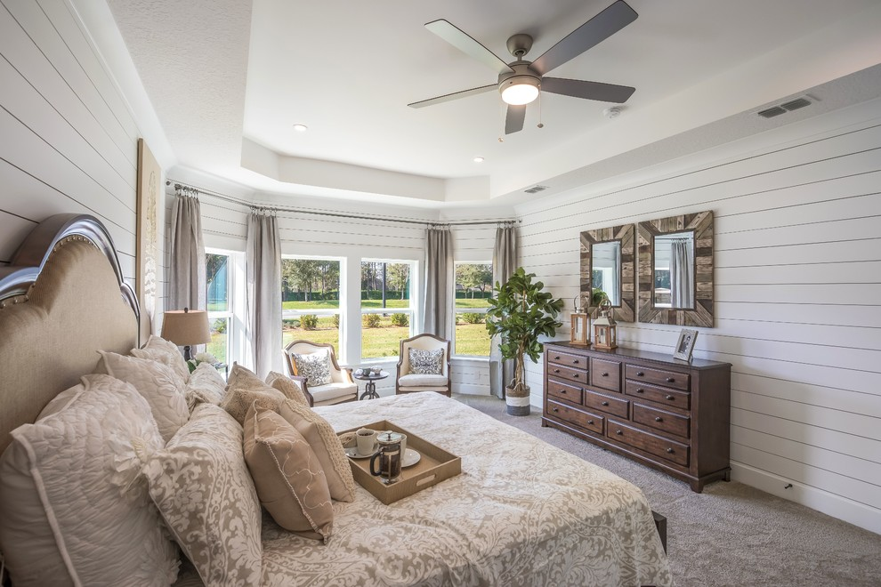 Example of a transitional carpeted and gray floor bedroom design in Jacksonville with white walls
