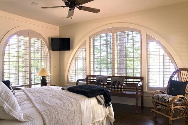 traditional dark wood floor bedroom idea in atlanta with beige walls - Louvered Bedroom Decor