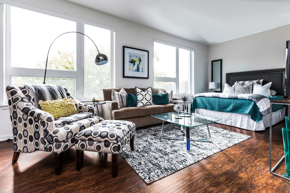 Trendy master dark wood floor and brown floor bedroom photo in Indianapolis with gray walls