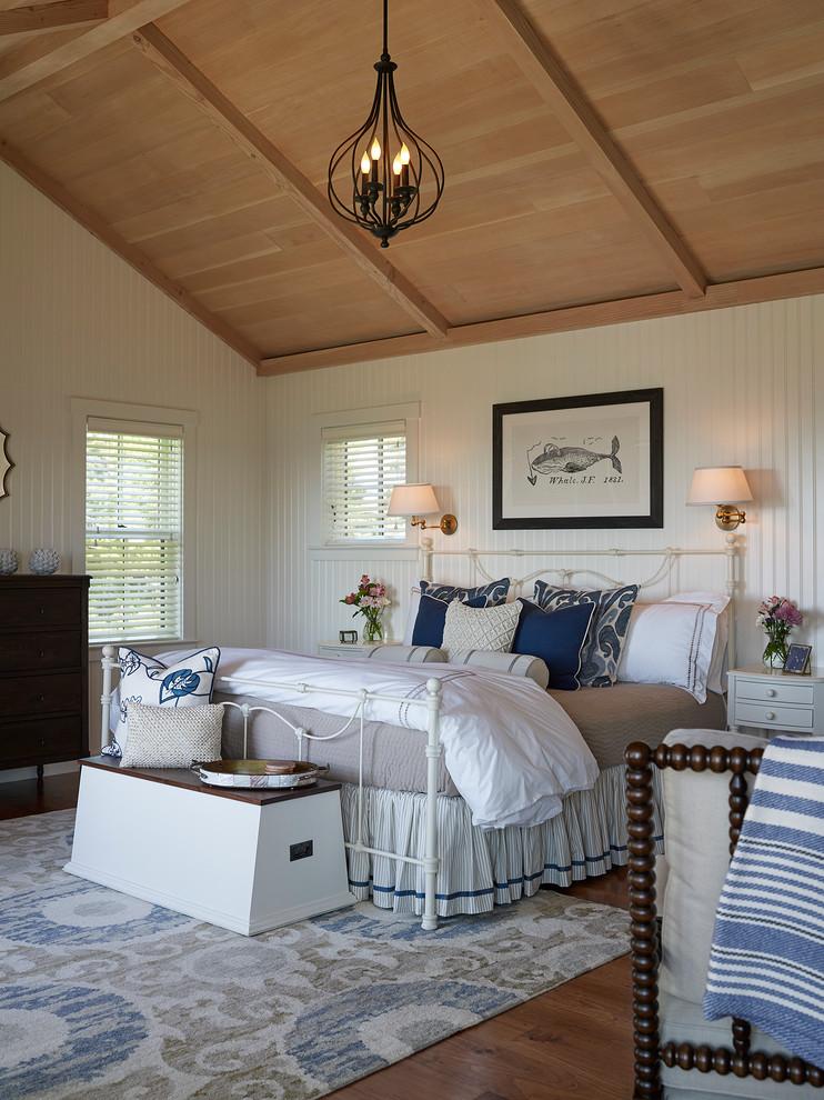 Bedroom - coastal master medium tone wood floor bedroom idea in Portland Maine with white walls