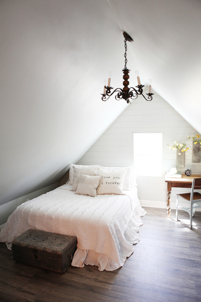 Inspiration for a small cottage guest medium tone wood floor bedroom remodel in Austin with gray walls and no fireplace