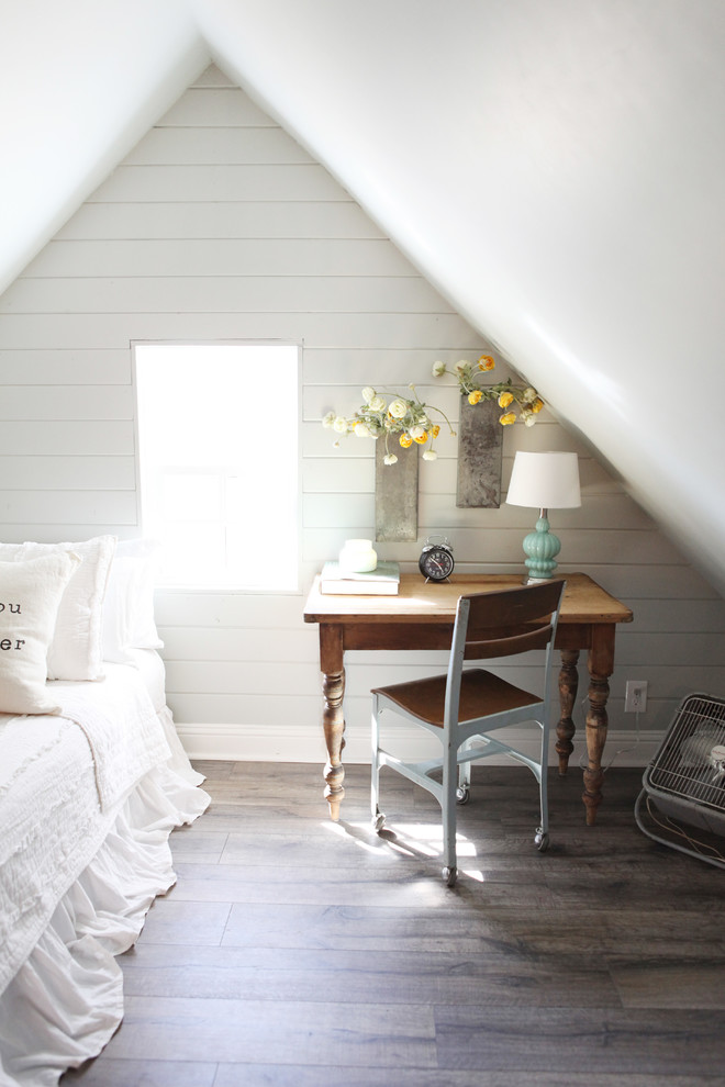 Small country guest medium tone wood floor bedroom photo in Austin with gray walls and no fireplace