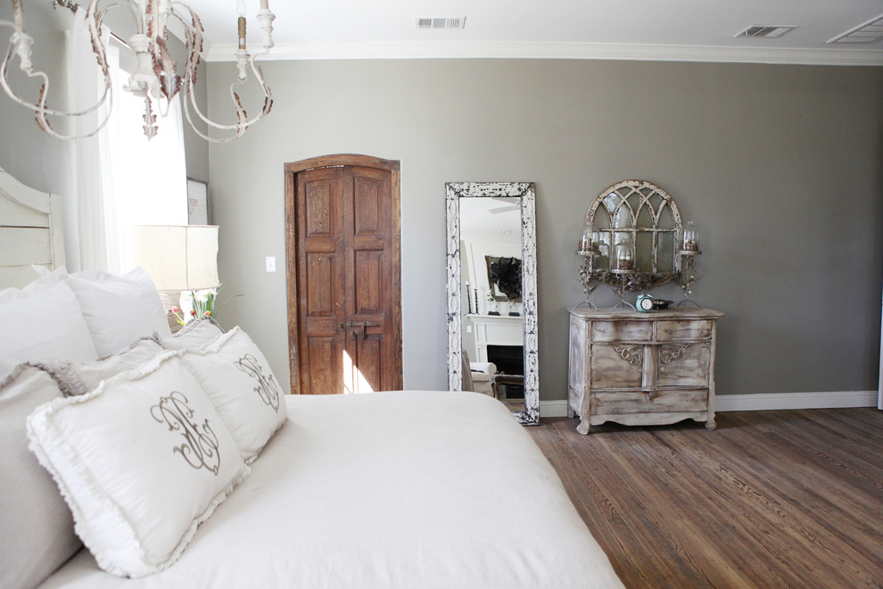 Small cottage master medium tone wood floor bedroom photo in Austin with gray walls and no fireplace