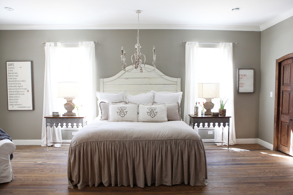 Example of a mid-sized cottage chic master medium tone wood floor bedroom design in Austin with gray walls and no fireplace