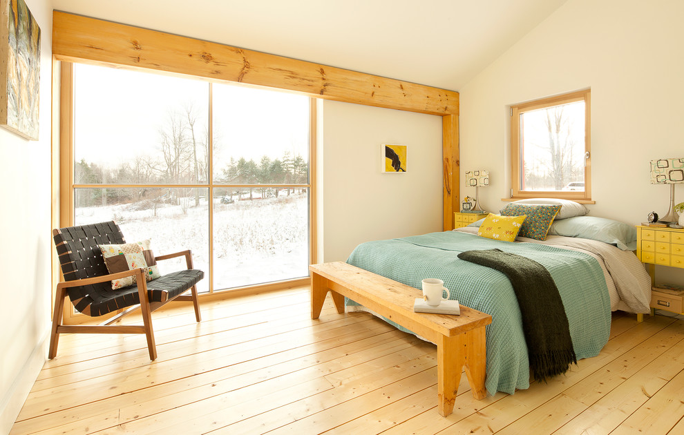 Bedroom - contemporary yellow floor bedroom idea in Portland Maine with white walls