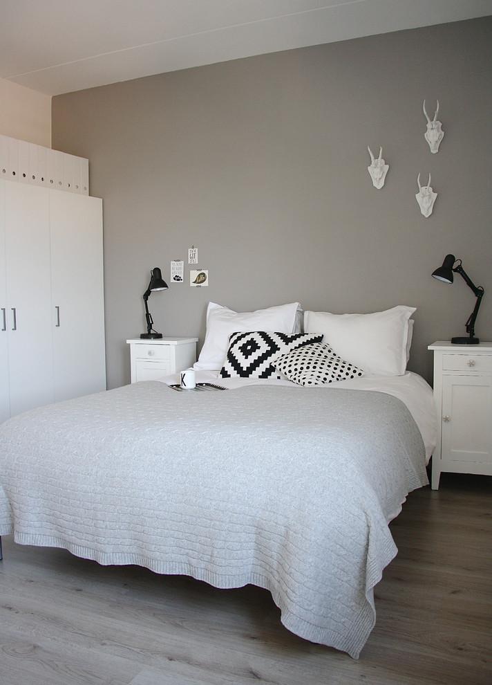 Bedroom - scandinavian light wood floor bedroom idea in Amsterdam with gray walls