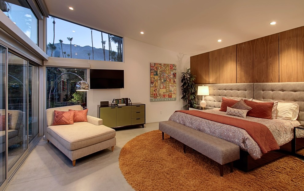 Example of a large mid-century modern master concrete floor bedroom design in Other with white walls