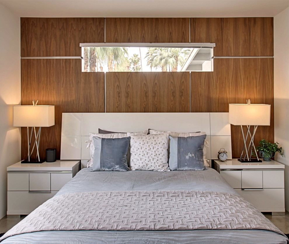 Inspiration for a large 1960s master concrete floor bedroom remodel in Los Angeles with white walls