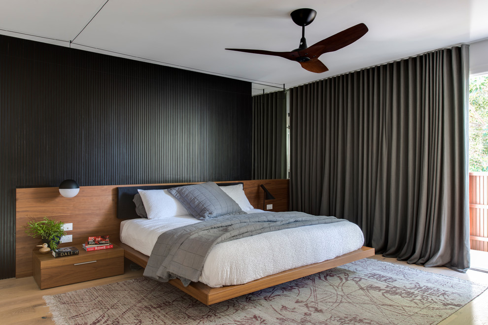 Inspiration for a mid-sized contemporary master light wood floor and beige floor bedroom remodel in Sydney with white walls