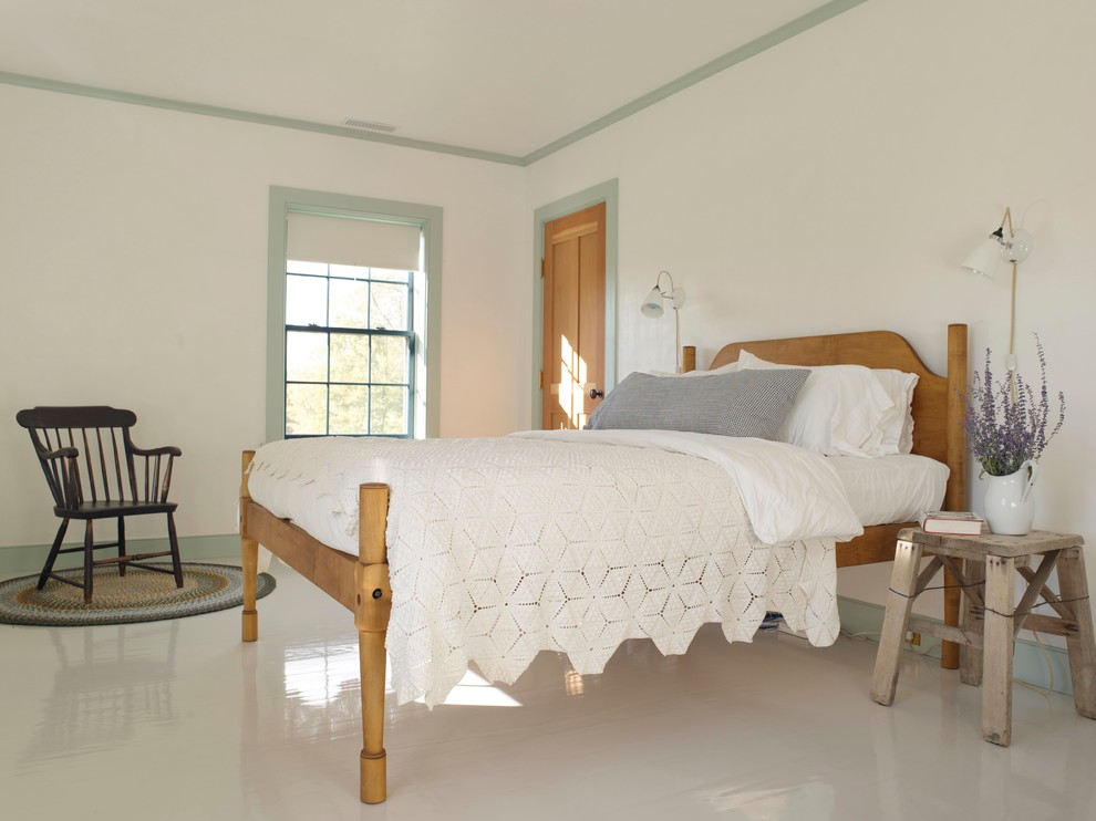 Example of a country painted wood floor and white floor bedroom design in New York with white walls