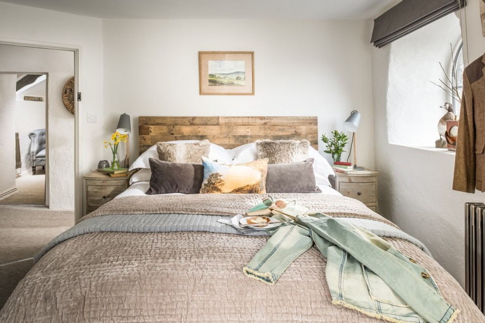 Mid-sized cottage master carpeted bedroom photo in Cornwall with white walls
