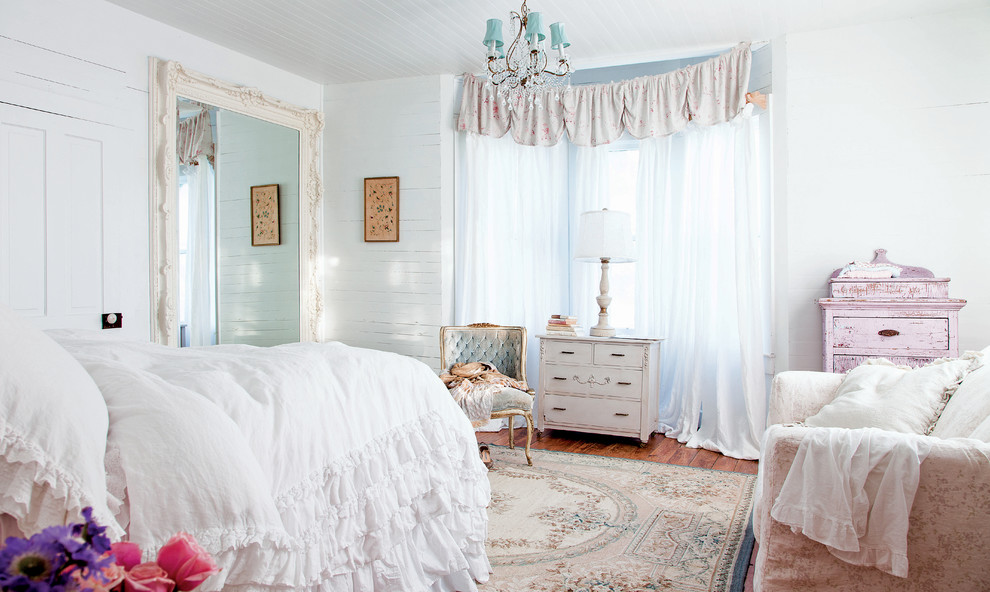 Example of a cottage chic bedroom design in Los Angeles with white walls