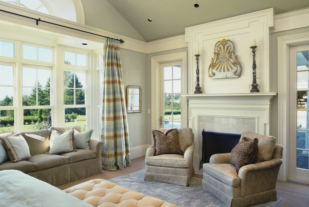 Example of a classic bedroom design in Portland with gray walls and a standard fireplace