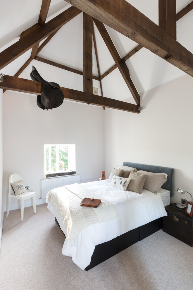 Bedroom - cottage carpeted bedroom idea in Surrey with white walls