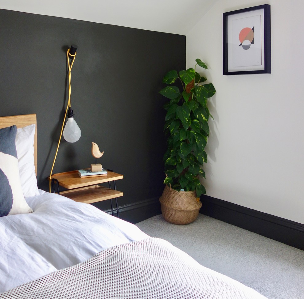 Example of a large danish guest carpeted and gray floor bedroom design in Other with white walls, a standard fireplace and a metal fireplace