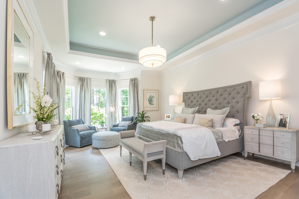Inspiration for a transitional master medium tone wood floor and brown floor bedroom remodel in Other with beige walls