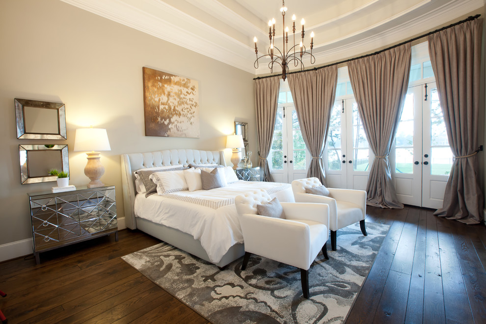 Inspiration for a timeless dark wood floor bedroom remodel in Dallas with beige walls